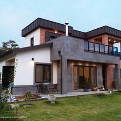 청원3호 팔봉리 45평형 ALC복층주택: W-HOUSE의  전원 주택