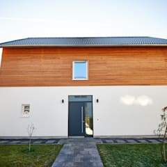 Passive house by PassivHausPartschefeld, Country Solid Wood Multicolored