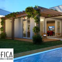 Jardines en la fachada de estilo  por Edifica Arquitetura e Design