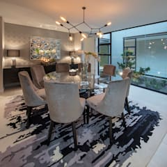 :  Dining room by Spegash Interiors,