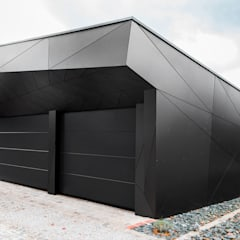 Garage/shed by plusEnergieArchitektur