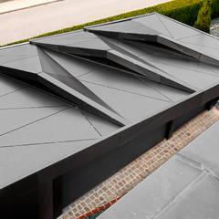 Garajes de estilo ecléctico por plusEnergieArchitektur