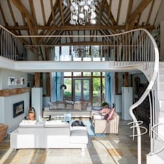 Replacement curved stair design for a barn conversion:  Stairs by Bisca Staircases