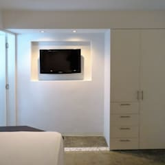 Apartamento de Playa: Cuartos de estilo  por RRA Arquitectura,