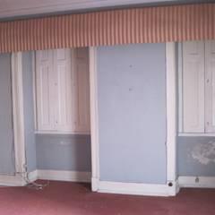 Reabilitação integral de edifício para moradia unifamiliar: Casas unifamilares  por West Gate, lda