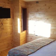 Kimche Lodge: Dormitorios de estilo  por Kimche Arquitectos