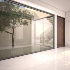 JARDIN INTERIOR: Jardines de invierno de estilo minimalista por SEZIONE
