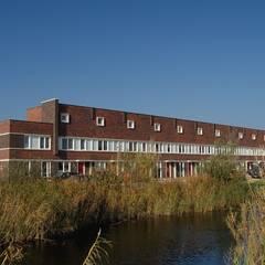 Woningbouw Singelkwartier Schuytgraaf, Arnhem:  Rijtjeshuis door Verheij Architecten BNA