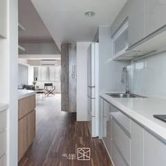 Kitchen units by 禾廊室內設計,