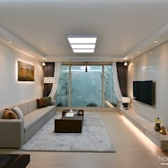 부산 호텔을 컨셉으로한 24평 아파트(2): 노마드디자인 / Nomad design의  거실