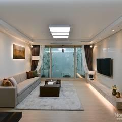 Salas de estilo rústico por 노마드디자인 / Nomad design