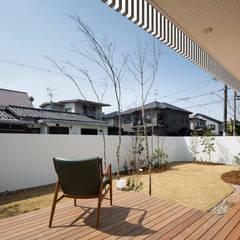 松原の家: 吉川弥志設計工房が手掛けた庭です。