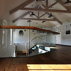 Frameless glass balustrade with wooden handrail at Wine Estate :  Floors by Ion Glass