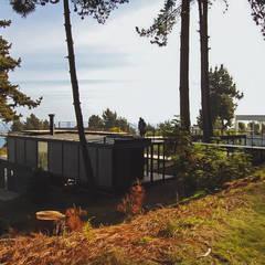 Casas de madera de estilo  por 2712 / asociados