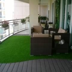Outdoor Living Room At DLF 5, Gurugram: modern Garden by Grecor