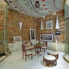 Salas multimedia de estilo ecléctico por Tribuz Interiors Pvt. Ltd.