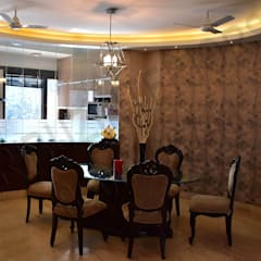 Dining room by Tribuz Interiors Pvt. Ltd.