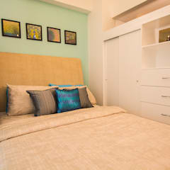 Malayan Plaza:  Bedroom by TG Designing Corner