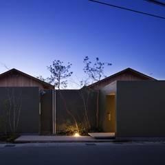 Casas de madera de estilo  por 吉川弥志設計工房