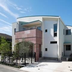 田園調布の家: 奥村召司+空間設計社が手掛けた二世帯住宅です。