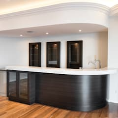 Theatre Room with Bar:  Media room by Moda Interiors