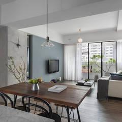 Living room by 沐光植境設計事業
