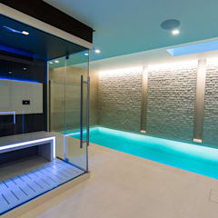 Luxury Indoor Pool with Counter Current Unit and Automatic Slatted Pool Cover :  Infinity pool by London Swimming Pool Company
