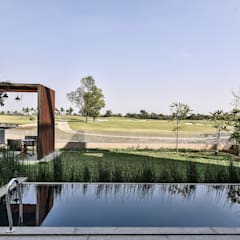 Premium Villa :  Infinity pool by Racheta Interiors Pvt Limited