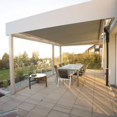 Conservatory by Schmidinger Wintergärten, Fenster & Verglasungen, Modern Glass