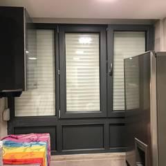 Janelas e portas modernas por homify Moderno
