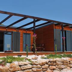 Casas de madera de estilo  por Discovercasa | Casas de Madeira & Modulares, Moderno Madera Acabado en madera