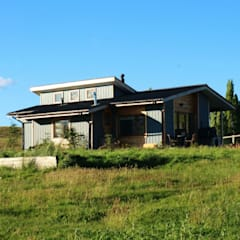 Diseño y Construcción de Casa Las Lomitas de Panguilemu en Coyhaique: Casas unifamiliares de estilo  por casa rural - Arquitectos en Coyhaique