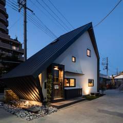 カフェのような事務所: 神谷徹建築設計事務所が手掛けたオフィスビルです。
