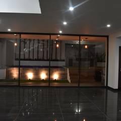 CASA RCP : Salas de estilo  por DEVELOP ARQUITECTOS