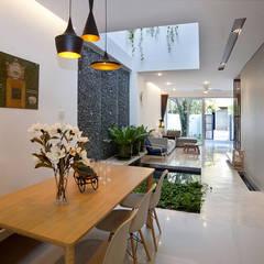 Thiết Kế Nhà Ống 2 Tầng 790 Triệu Gần Gũi Với Thiên Nhiên:  Phòng ăn by Công ty TNHH Xây Dựng TM – DV Song Phát