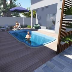 Espaço da piscina com porcelanato: Piscinas de jardim  por Janete Krueger Arquitetura e Design