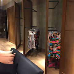 Showroom de Fábrica - Moda Feminina: Lojas e imóveis comerciais  por ICONO Projetos e Interiores