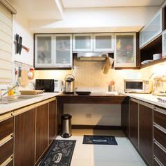 Sonata Private Residences: modern Kitchen by TG Designing Corner