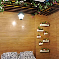 Lounge Decor at  DLF 4, Gurugram:  Walls by Grecor