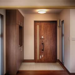 玄関ホール: 株式会社青空設計が手掛けた廊下 & 玄関です。