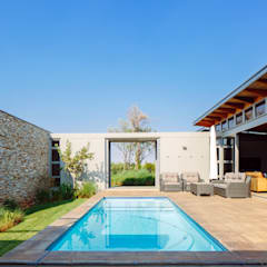 modern lodge:  Garden Pool by drew architects + interiors, Modern Stone