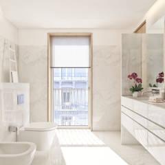 Santos Design - Stone Capital: Casas de banho  por Onstudio Lda,