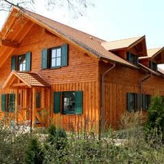 Wohnhaus in 14621 Schönwalde: rustikale Häuser von SCHOß INGENIEUR GmbH