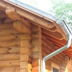 Fassade: rustikale Häuser von SCHOß INGENIEUR GmbH