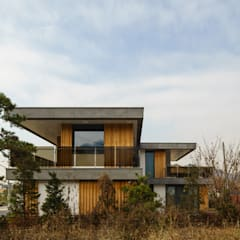 Condominios de estilo  por 위즈스케일디자인, Moderno Madera Acabado en madera