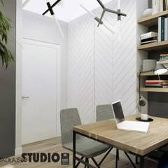 przytulny gabinet: styl , w kategorii Domowe biuro i gabinet zaprojektowany przez MIKOŁAJSKAstudio