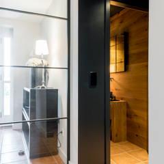 Pasillos y vestíbulos de estilo  por Ohlde Interior Design