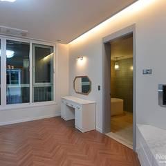 66평 엘크루블루오션 - 부산: 노마드디자인 / Nomad design의  침실
