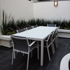 """Proyecto """"Red Chair"""": Terrazas de estilo  por Franko & Co."""