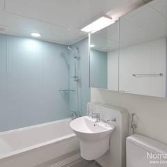 39평 대동황토방 아파트 - 양산: 노마드디자인 / Nomad design의  욕실